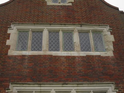 Large 6 panel stone window with leaded glass.