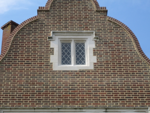Repaired top small top floor stone window.