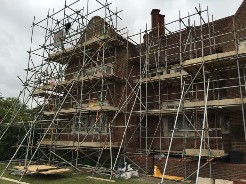House fully scaffolded for the stone restoration work